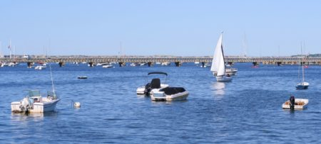 Several boats on the water in Cape Cod fishing