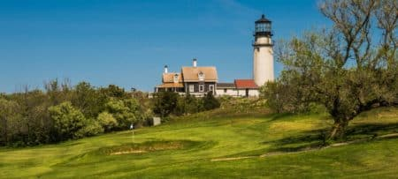 Golf course on Cape Cod with view of lighthouse