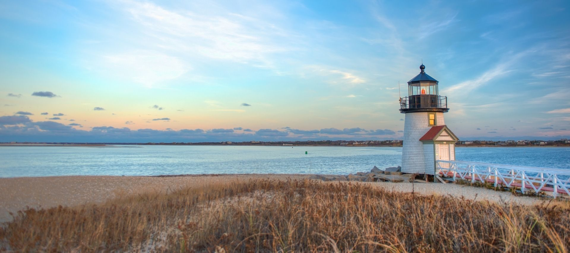 View of lighthouse and beach on Nantucket during the fall