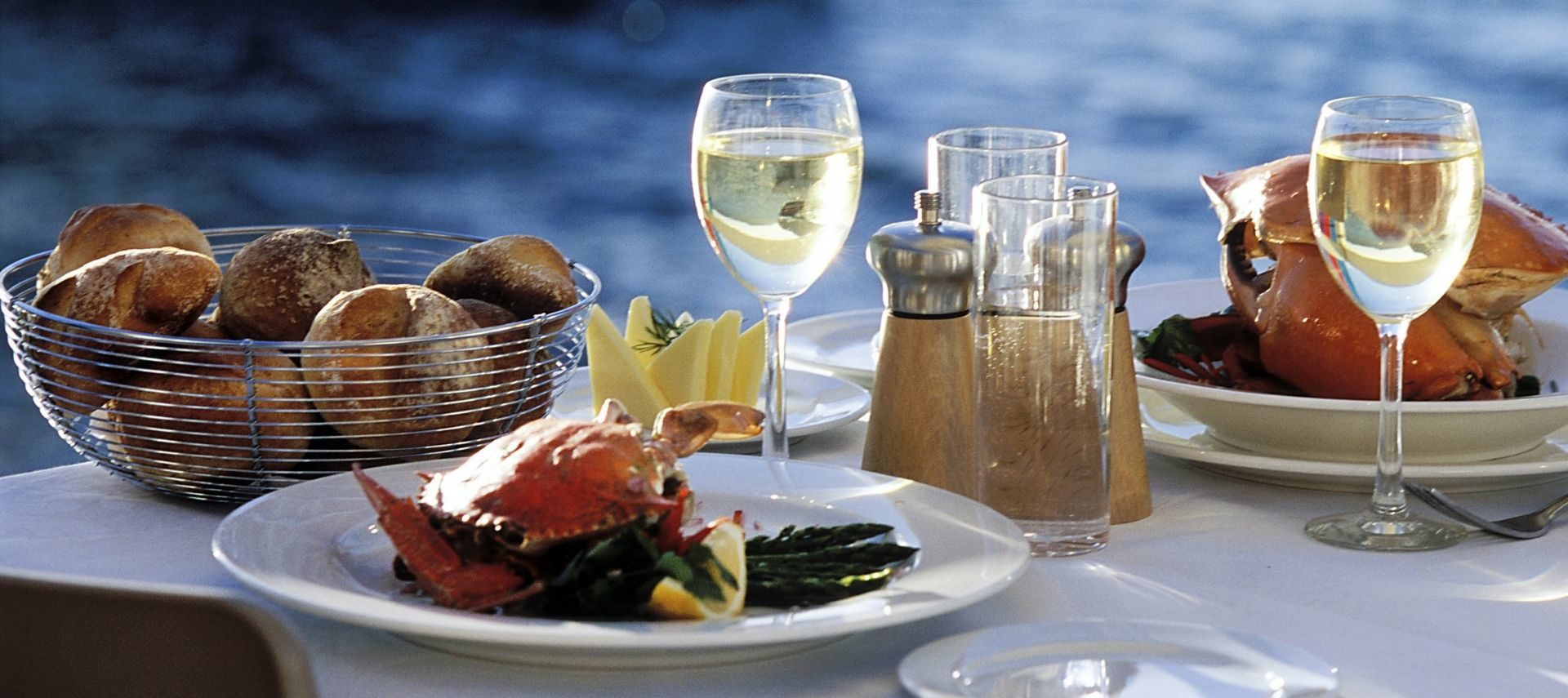 Dining table near the water with fresh seafood