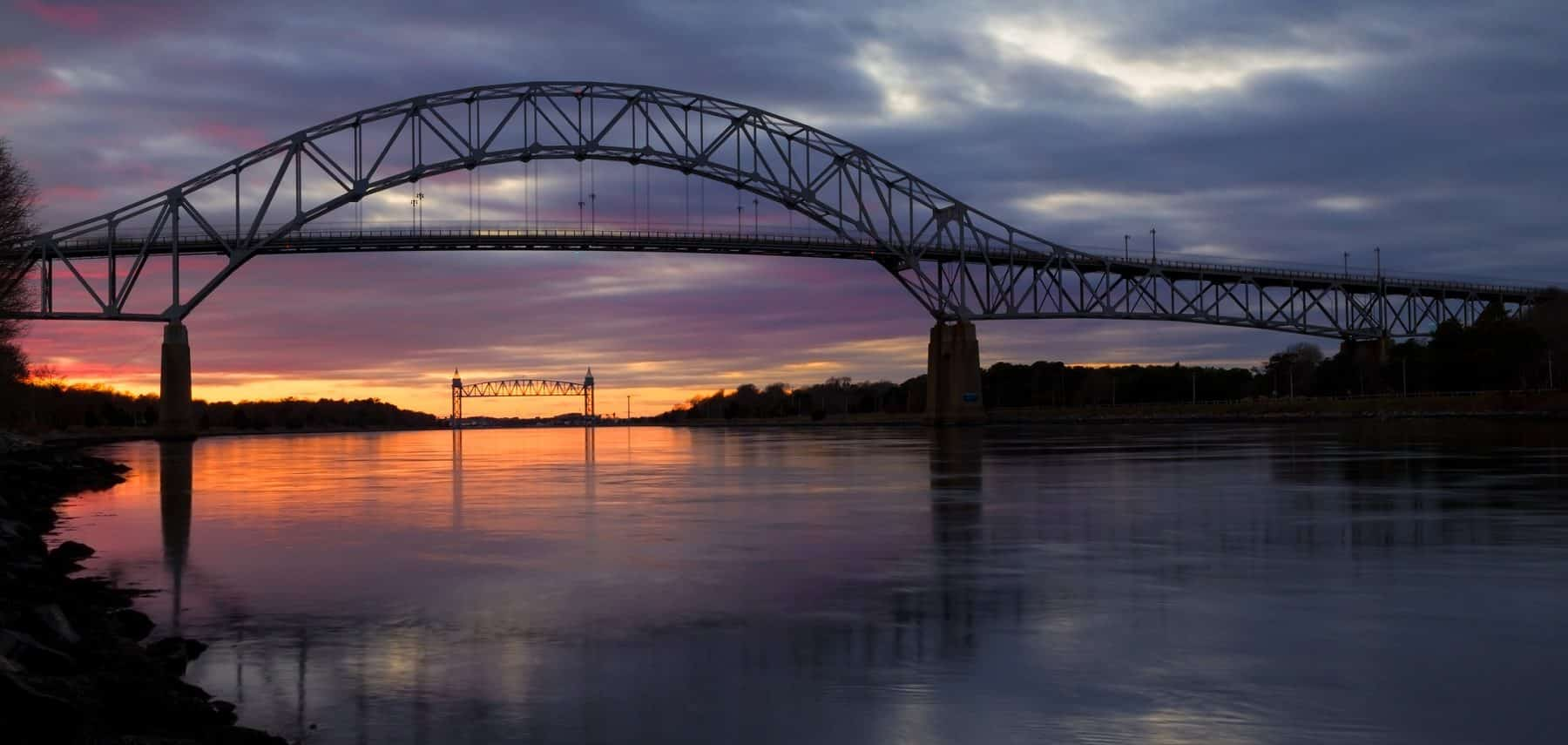 The Bourne Bridge at the Cape Cod Canal during sunset