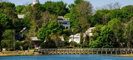 View of Wellfleet Bay's bridge and lush green landscaping