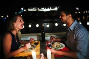 Couple enjoying dinner at one of the romantic restaurants on Cape Cod